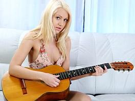 Kristina loves to play her guitar