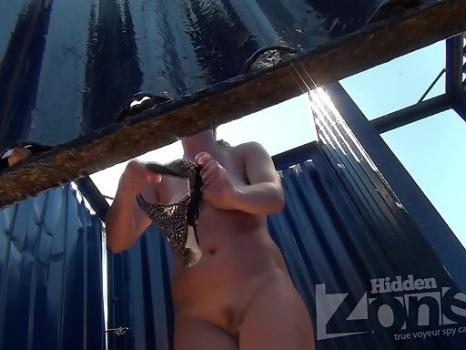 Bc2078# Tanned blonde dresses a swimsuit in the beach cabin. Beautiful tanned body and shaved pussy