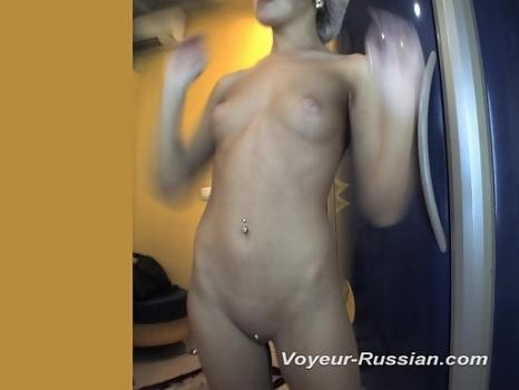Pv540# Hidden camera in the solarium. A young beauty undresses and looks at herself in the mirror. E