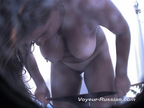 Pv512# Tanned brunette dresses a swimsuit in the beach cabin. In the lens of our hidden camera, ther
