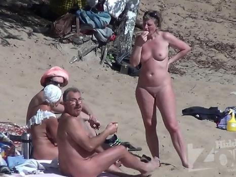 Nu1862# On the nudist beach there are always men who are looking at naked women. We often see them i