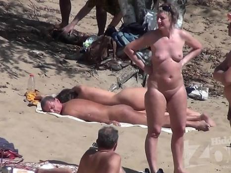 Nu1854# Naked people walking, talking, looking at each other. All of this - a nudist beach! Probably