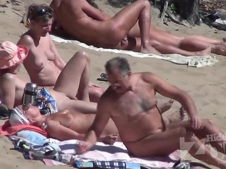 Nu1848# Nudists have a rest on the beach. Their naked bodies on display. Our subscribers can enjoy t