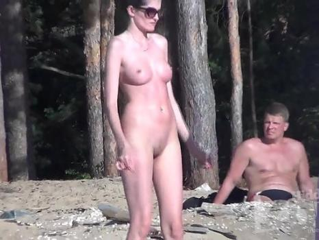 Nu1766# The company nudists resting on the beach. Naked women are beautiful under the rays of the su