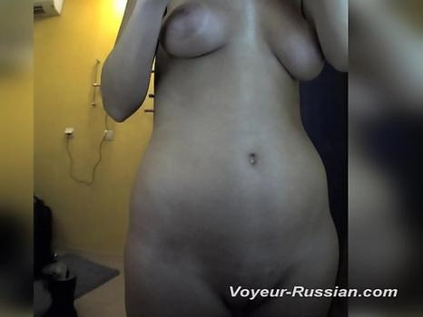 Pv668# Tanned girl undressed and examines herself in the mirror. In the lens of the hidden camera, h
